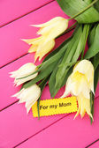 Beautiful white tulips on color wooden background — Stock Photo
