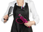 Hairdresser in uniform with working tools — Stock Photo