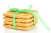 Sweet cookies tied with green ribbon isolated on white — Stock Photo