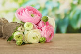 Ranunculus (persian buttercups) on green background — Stock Photo
