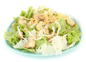 Caesar salad on blue plate, isolated on white — Stock Photo