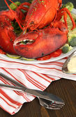 Red lobster on platter on table close-up — Stock Photo