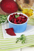 Sliced beetroot on bowl on wooden table close-up — Stock Photo