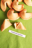 Fortune cookies on green tablecloth — Stockfoto