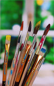 Many brush in paint on window background — Stok fotoğraf