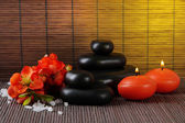 Spa stones with flowers and candles — Stock Photo