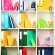 White office shelves with different stationery, close up — Stock Photo #24513755