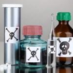 Постер, плакат: Deadly poison in bottles on grey background