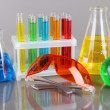 Test-tubes with colorful liquids on gray background — Stock Photo