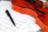 Classical violin on notes — Stock Photo