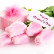 Beautiful bouquet of pink tulips and gift for Mother's Day, isolated on white — Stock Photo #24520121