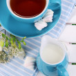 Beautiful tea composition on wooden picnic table close-up - Foto de Stock