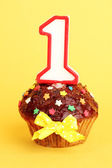 Birthday cupcake with chocolate frosting on background — Stock Photo