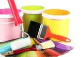 Paint pots, paintbrushes and coloured swatches — Stock Photo