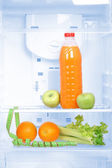 Open refrigerator with diet food — Stock Photo