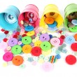 Colorful buttons strewn from buckets — Stock Photo #24533211