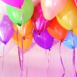 Many bright balloons under ceiling close-up — Stock Photo #24539019