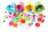 Colorful buttons strewn from buckets — Stock Photo