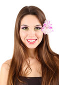 Young beautiful girl with flower in her hair, isolated on white — Stock Photo