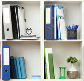 White office shelves with different stationery — Stock Photo