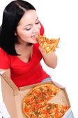 Hermosa chica come pizza aislado en blanco — Foto de Stock