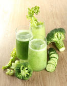 Glasses of green vegetable juice — Stock Photo