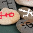 Fortune telling with symbols on stones — Stock Photo #24541271