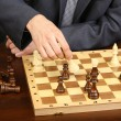 Young business man playing chess — Stock Photo #24549805
