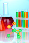 Molecule model and test tubes with colorful liquids — Stock Photo