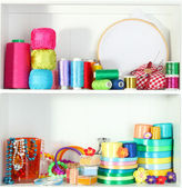 Shelves with thread and material for handicrafts — Stock Photo