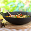 Noodles with vegetables on wok on nature background — Photo