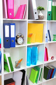 White office shelves with different stationery — Stok fotoğraf