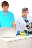 Physician and assayer during research — Stock Photo