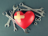 Heart and tools. Concept: Renovation of heart. On color background — Stock Photo