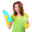 Young woman wearing rubber gloves with cleaning supplies, isolated on white — Stock Photo #24588733
