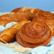 Composition with buns, on color napkin, on color background — Stock Photo