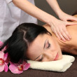 Woman in spa salon getting massage — Stock Photo #24587081