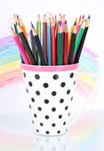 Colorful pencils in cup isolated on white — Stock Photo