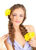 Młoda kobieta z fryzurę i kwiaty — Zdjęcie stockowe