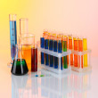 Colorful test tubes on light background — Stock Photo