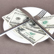 Stock Photo: Money on plate on grey background