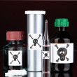 Deadly poison in bottles on black background — Stock Photo #24597691
