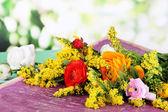 Beautiful flowers on bright background — Stock Photo