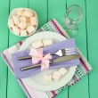 Table setting in violet and white tones on color  wooden background — Stock Photo