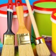 Set for painting: paint pots, brushes, palette of colors on blue background — Stock Photo #24601673