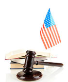 Wooden gavel, books and American flag isolated on white — Stock Photo