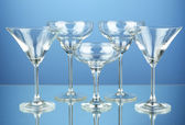 Cocktail glass set on blue background — Stock Photo