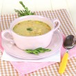 Nourishing soup in pink pon wooden table close-up — Stock Photo #24611333