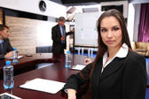 Businesswoman in business training — Stock Photo