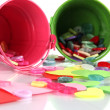 Colorful buttons strewn from buckets close-up — Stock Photo #24625055